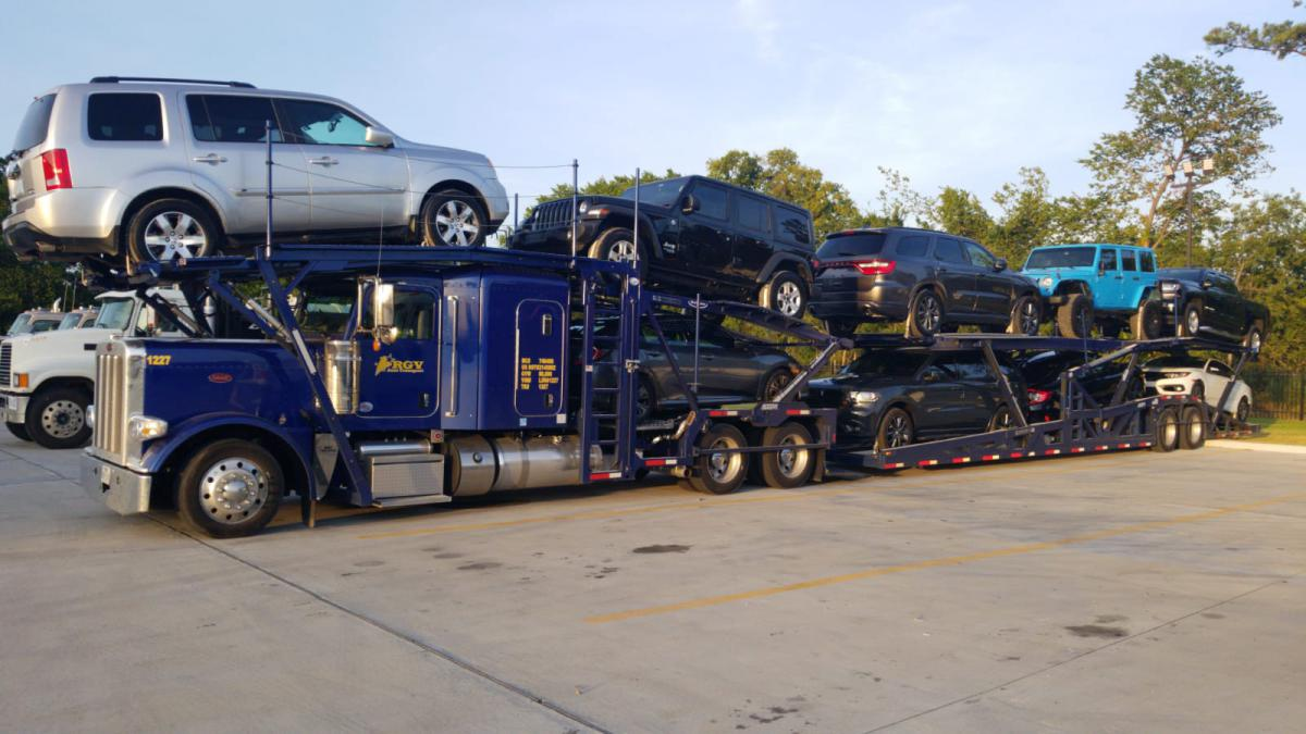 An auto transport service's open carrier.