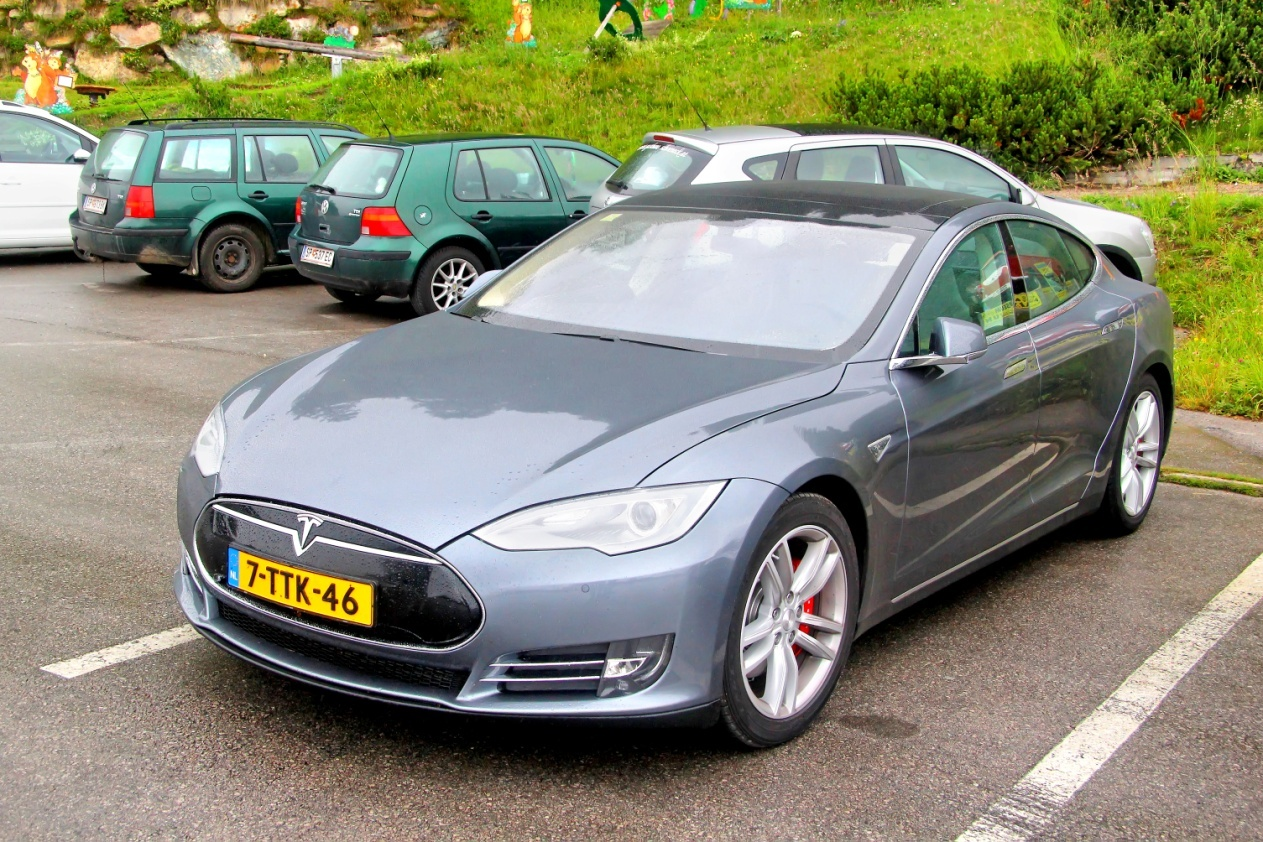 a standing Tesla