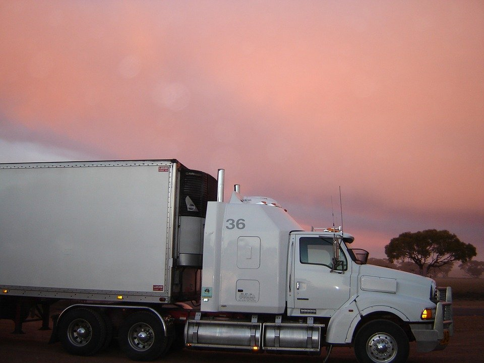 A car being transported across the country via enclosed shipping.