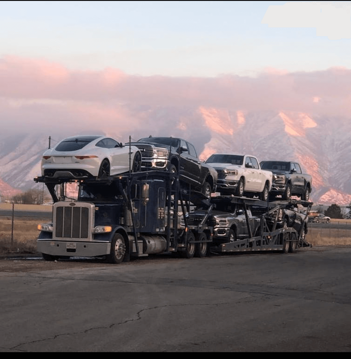 A couple of cars being transported across the country.